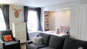 Caratteristiche del design del soggiorno con un letto