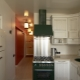 Design small kitchen area of ​​6 square. m with fridge