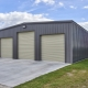 Metal garage: features and benefits of metal structures for storing a car
