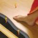 Heated floor in the bath: the criteria for choosing a design